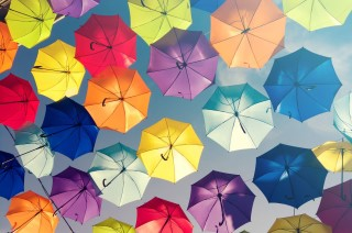 Colorful-umbrellas-in-the-sky,-street-decoration.-Colorful-background-517991730_3928x2623.jpeg